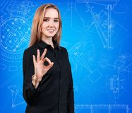 Young business woman present blueprint. Royalty Free Stock Photos