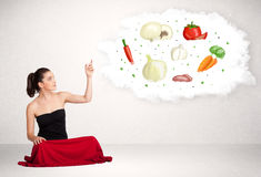 Young business woman presenting cloud with nutritional vegetable Stock Images