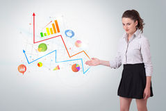 Young business woman presenting colorful charts Royalty Free Stock Photos