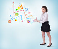 Young business woman presenting colorful charts and diagrams Stock Photography