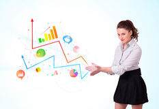 Young business woman presenting colorful charts and diagrams royalty free stock photo