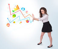 Young business woman presenting colorful charts and diagrams Stock Images