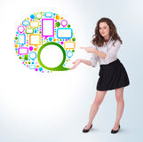 Young business woman presenting colourful speach bubble. On bright background Royalty Free Stock Photo