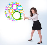 Young business woman presenting colourful speach bubble. On bright background Stock Photo