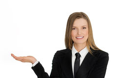 Young business woman presenting with hand Stock Photo