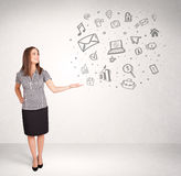 Young business woman presenting hand drawn media icons Stock Photography