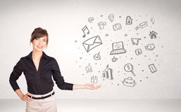 Young business woman presenting hand drawn media icons Royalty Free Stock Image
