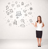 Young business woman presenting hand drawn media icons Royalty Free Stock Images