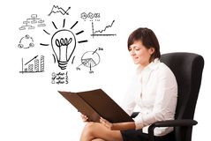 Young business woman presenting light bulb with various diagrams. And charts on whiteboard isolated on white Royalty Free Stock Photos