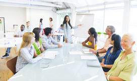 Young Business woman presenting in Office Stock Photos