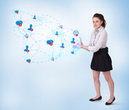 Young business woman presenting social map Stock Photo