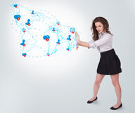 Young business woman presenting social map Royalty Free Stock Images