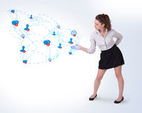 Young business woman presenting social map Stock Image