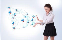 Young business woman presenting social map Royalty Free Stock Photos