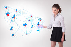 Young business woman presenting social map Stock Photography