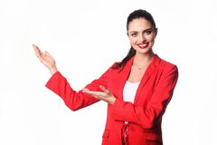 Young business woman is presenting something. Royalty Free Stock Photography