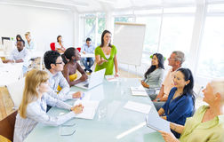 Young Business woman presenting to her colleagues. Young Business women presenting to her colleagues Stock Image