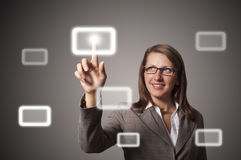 Young business woman presses a button touch Stock Images