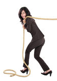 Young Business Woman Pulling A Rope Royalty Free Stock Images