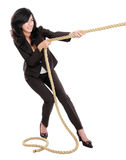 Young business woman pulling a rope Stock Photography