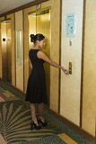 Young Business Woman Pushing Elevator Button Royalty Free Stock Photography