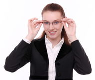 Young business woman puts on specticales. Stock Image