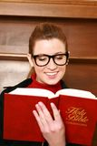 Young business woman reading bible Royalty Free Stock Photography