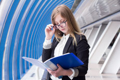 Young business woman reading documents folder Stock Photo