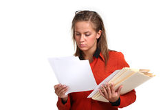 Young business woman reading files Royalty Free Stock Photography