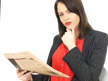 Young Business Woman Reading a Newspaper Royalty Free Stock Photo