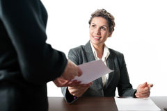 Young business woman receiving a contract Royalty Free Stock Photos