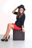 Young business woman in a red skirt and black jacket Royalty Free Stock Photography