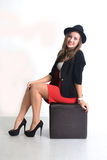 Young business woman in a red skirt and black jacket  Stock Image