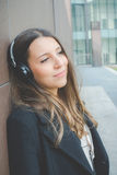 Young business woman relaxes listening to music in the city Royalty Free Stock Photos
