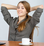 Young business woman relaxing at Royalty Free Stock Photos