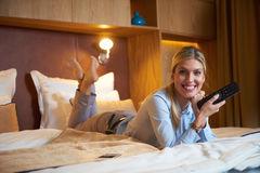 Young business woman relaxing in hotel room Royalty Free Stock Photos