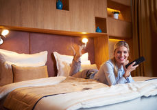 Young business woman relaxing in hotel room Royalty Free Stock Photography
