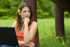 Young business woman relaxing, working on laptop. Computer on meadow royalty free stock photos