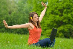 Young business woman relaxing, working on laptop c. Omputer on meadow royalty free stock image