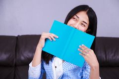 Business woman rests at the sofa and reading a book Royalty Free Stock Photo