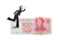 Young business woman running on money Royalty Free Stock Photo