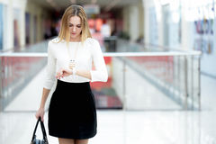 Young business woman in a rush, glancing at time on wristwatch Stock Photography