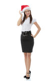 Young business woman in santa hat Stock Photo