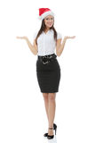 Young business woman in santa hat Stock Photography