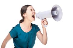 Young business woman screaming and holding loud- Royalty Free Stock Photos