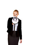 Young business woman screaming through megaphone Stock Photography