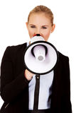 Young business woman screaming through megaphone Royalty Free Stock Images
