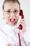 Young business woman screaming on the phone. She is shokked Royalty Free Stock Photos