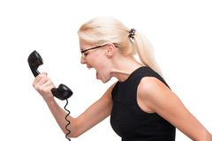Young business woman screaming on telephone Royalty Free Stock Photos