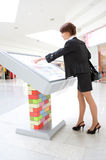 Young business woman select goods. On interactive display Royalty Free Stock Photography